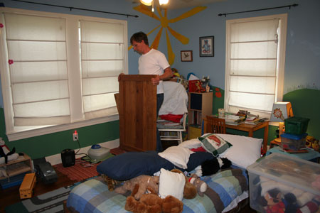 Andy pulls pieces of the bed into Luke's room.