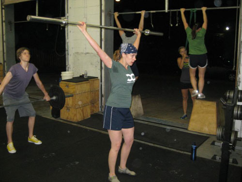 Cindy holds up the 45# bar at the end of the hang power snatch