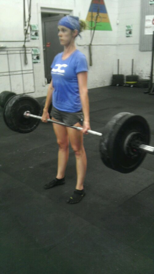Cindy at the top of a 165# deadlift