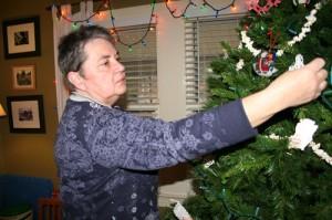 Susan decorates the Christmas tree, 2009